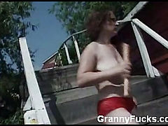 Redhead Granny Masturbates with Dildo