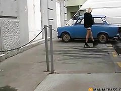The girl pushes her panties in the car