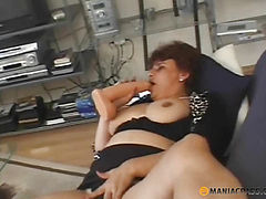 Woman lying on the couch caressing her pussy
