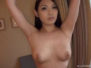 Curvy Asian babe displaying her big ass while fingering pussy