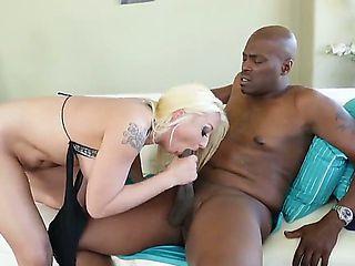 Hot blonde Leya Falcon with big fake tits rides massive black dick