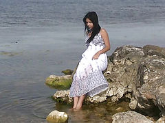 Flv movie of excellent brunette teen with perfect tits undressing outdoors on the seaside.