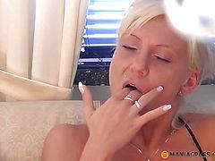 Busty bitch fucks her pussy