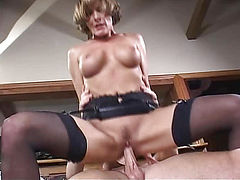 Woman in black stockings fucks guy