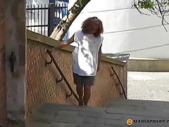 Baby walking on the street in search of a toilet