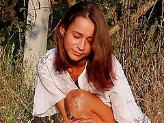 Online movie of amazing slim teen cutie posing absolutely naked with a basket of apples.