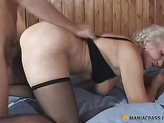 Woman standing doggy fucked on the bed