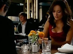 Olivia Wilde standing in front of a guy who is sitting on a couch and pulling down her jeans to reveal her butt in a thong. She then climbs into the guy's lap, taking her wet shirt off to expose her bra as well while we get some more looks at her panties