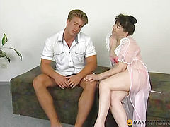 A woman with a hairy pussy sports with a man