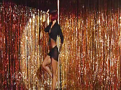 Salma Hayek does very hot striptease at strip club while wearing fully see through fishnet outfit and nipple pasties and black thong. Then we see  her lying on bed in very sexy lingerie. From Americano.