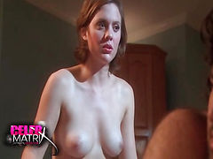Olivia Alaina May straddling a guy in bed as he lies on his stomach and she sits on the back of his legs while holding a whip and wearing nothing but a strap-on. We get a nice view of her bare breasts as she talks to the guy and tentatively uses the whip