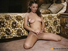 Teen spreads her legs while sitting on the floor