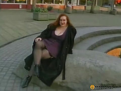 Large bitch sitting by the fountain