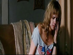 Christina Ricci wearing a pair of white panties and a cut-off shirt as a guy leads her through a field with a chain wrapped around her waist. Christina then lifts her arms up in a sexy pose, revealing the bottom of her breasts as her shirt lifts up. From