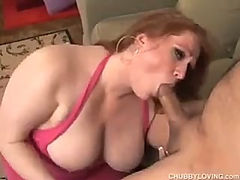 Tremendous fat redhead sucking a big dick