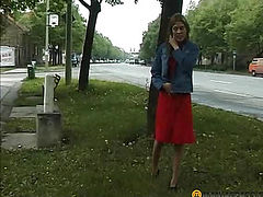 The girl sat down pissing on the tall grass