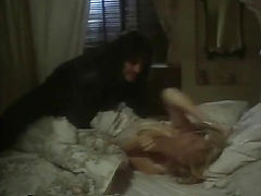 Shannon Tweed naked completely while underneath a guy as they have sex on a bed, her amazing breasts visible. From Night Eyes 3.