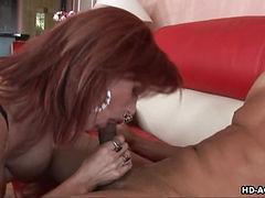 Delicious redhead gal gobbles up a big black piston