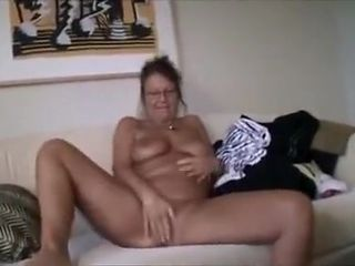 Chubby blonde milf shows off her big tits and wet pussy on webcam
