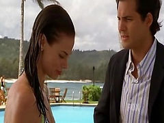 Brooke Burns getting out of a pool in a green bikini and then standing and talking with a guy. Then we see Brooke Burns removing her dress to reveal a black bra and panties and then getting on top of a guy on a bed and kissing him passionately and talking