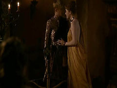 Carice van Houten approaching a guy and letting her robe fall open to reveal her breasts and her butt from the side. Her robe then comes off entirely as she makes out with the guy and he lays her back on a table to have sex with her, Carice's breasts in v