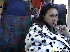 Stroking her pussy while sitting on the bus