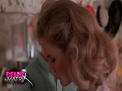 Kelly Preston removing her bra to reveal her nice breasts, which a guy touches. We then see her take off her panties and give us a look at her ass and bush before climbing into bed with the guy, topless underneath him as they have sex.