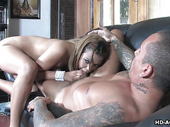 Delicious blonde babe munches on a big piston