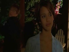 Jessica Alba showing cleavage while strapped to the top of a car as part of her dress is ripped off, leaving behind only some white panties and a white bra.Then Jessica Alba untying from herself from the top of a car and then dropping down beside it, wher