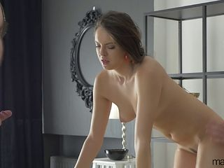 Slender brunette receives a sensual massage and gets boned by two guys