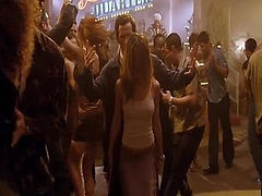 Jennifer Aniston showing some pokey nipples in a white tank top as she does a sexy dance with a couple guys in a club and then talks to someone afterwards. From Along Came Polly.