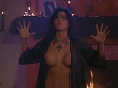 Julie Strain nude first seen having hot sex with some guy on the floor. Then we see her in lesbian sex action. From Sorceress.