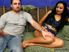 The girl in a beautiful dress sucks dick a guy