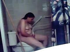 Chubby chick uses shower head to masturbate