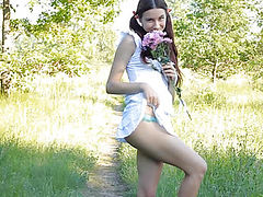 Sweet teen demonstrating her accurate fresh pussy on the nature in lustful online video.