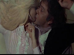 Ewa Aulin removing her clothes and giving us some sideview glimpses of her breasts. Then we see Ewa Aulin naked while making out with a guy. From Candy.