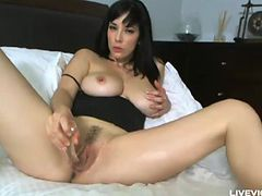 Pornstar Jelena Jensen plays with big natural boobs and trimmed pussy
