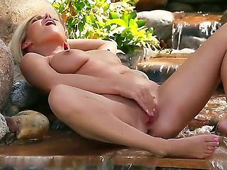 Niki Lee Young displays her nice big boobs in solo action