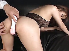 Riona Suzune looks sexy in black and her husband bends her over to toy her pink pussy with a vibrator until she cums