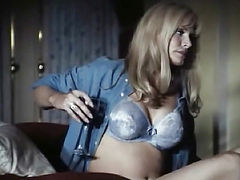 Shannon Tweed nude in various scenes and afterward in hot sex action with some guy. Her breasts and bush are exposed. From Indecent Behavior 2.