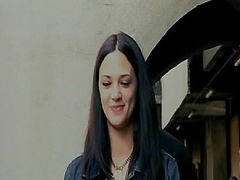 Asia Argento having her breasts swing back and forth while having sex with a guy doggy-style in a trailer. Then Asia Argento standing a black bra as she pulls down her panties to reveal her bush before she starts kissing a guy. From Scarlet Diva.