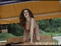 Mature Redhead Spreading Her Cunt
