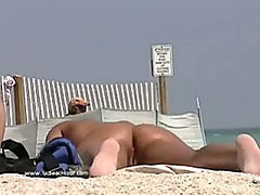 Check out a sexy girl at the beach