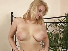 Busty blonde masturbating