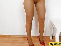 Brunette tantalise fake penis in panty-hose