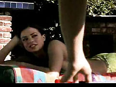 Candice Michelle and Belinda Gavin both naked having hot lesbian sex action by the pool. Their bare breasts are visible. From Roomate Wanted.