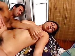 Babe with hairy pussy on the bed
