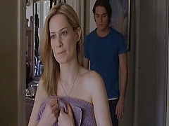 Camille Sullivan topless as she stands in front of a mirror and brushes her hair. A guy then enters the room, grabs her right breast from behind and then kisses her. They then move to the bed, where we see more of Camille's breasts while she has sex with