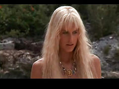 Daryl Hannah nude walking across some grass with her bare rear end showing and her long hair covering her breasts. From Splash.