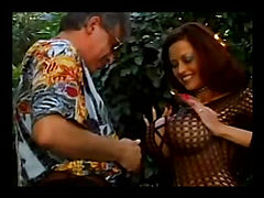 Professional bitch in fishnets stocking and long red nails playing with thick pierced vaginal lips